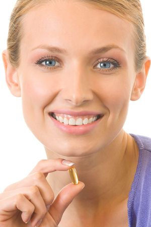 Young happy woman with Omega 3 fish oil capsula, isolated Stock Photo - 3413534