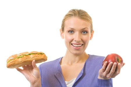 Woman with sandwich and apple, isolated on white photo