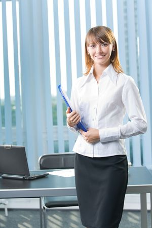 secretary office: Young happy smiling businesswoman at office Stock Photo