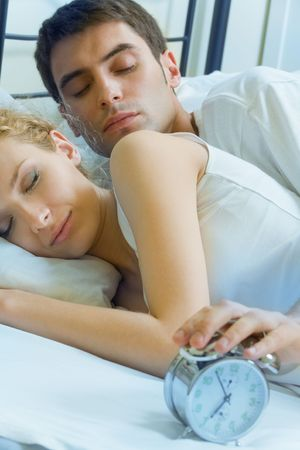 Young amorous couple waking up at the morning photo