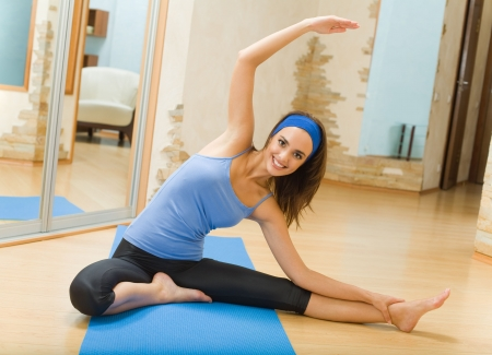 Young happy woman doing fitness exercises at home Stock Photo - 3505771