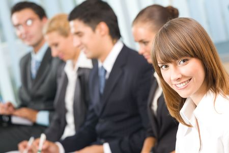 officeworker: Portrait of successful businesswoman at conference