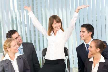 victorious: Successful happy businesswoman and businessteam at office
