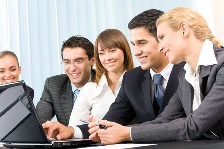 working together: Successful business-team working together at office Stock Photo