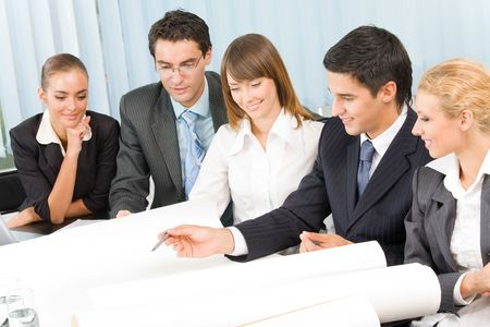 businessteam: Successful business-team working together at office Stock Photo