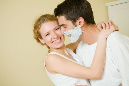 Young amorous couple having a fun together at home photo
