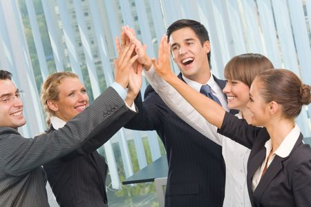 gesturing: Happy successful gesturing business team at office Stock Photo