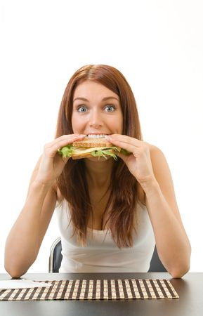 Very hungry gluttonous woman eating sandwich with cheese, isolated photo