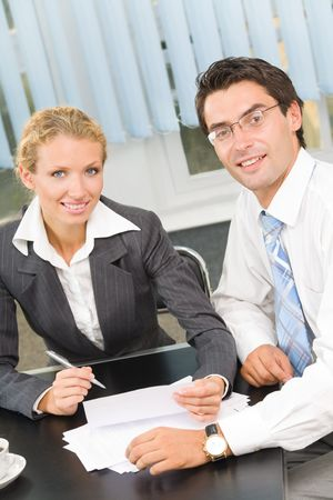 Two businesspeople working together at office photo
