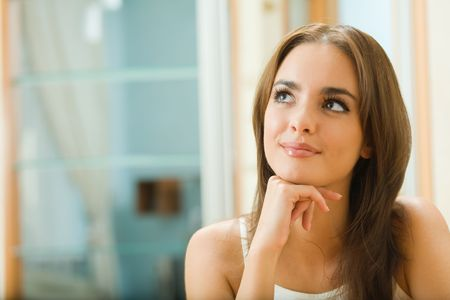 Portrait of young happy dreaming woman at home Stock Photo - 3662895