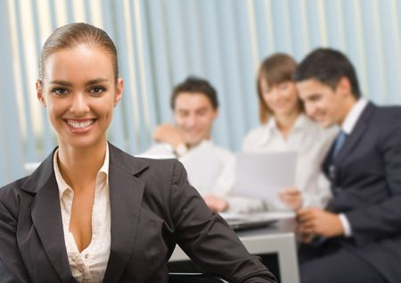 Portrait of successful businesswoman and business team at office meeting Stock Photo - 3662912