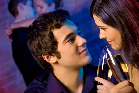 newyear night: Two amorous couples celebrating together at restaurant