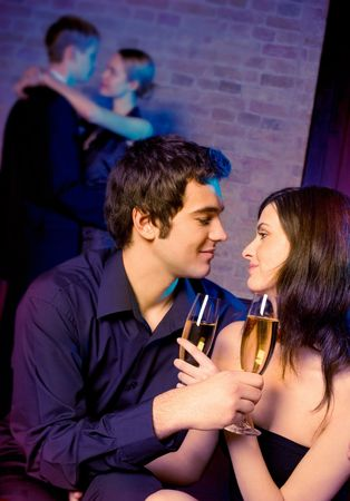 amorous: Two amorous couples celebrating together at restaurant