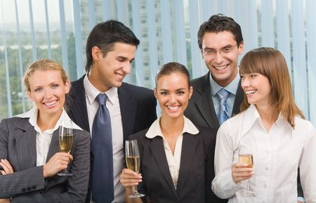 Happy business team celebrating with champagne at office photo