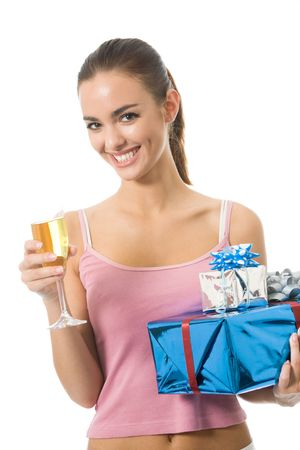 Young woman with gifts and champagne, isolated on white photo