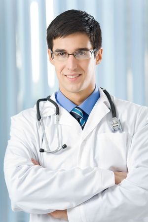 Happy doctor with stethoscope at office Stock Photo - 3767034