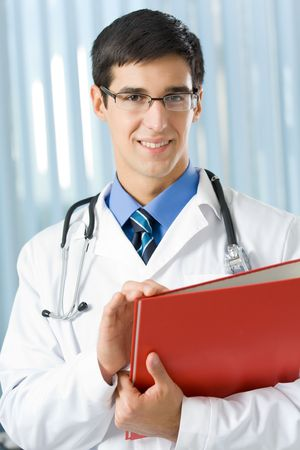 Happy doctor with stethoscope and documents Stock Photo - 3767036