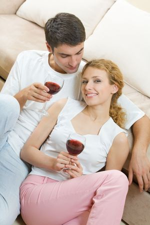 redwine: Young couple celebrating with red wine at home