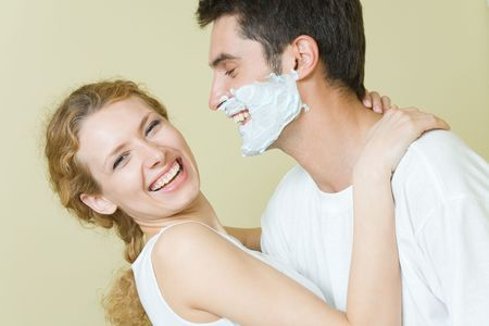 Young amorous couple having a fun together at home Stock Photo - 3794295