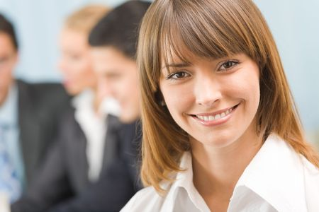 businessteam: Portrait of successful businesswoman and business-team at office meeting Stock Photo