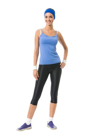 Full body portrait of woman in sportswear, isolated on white photo