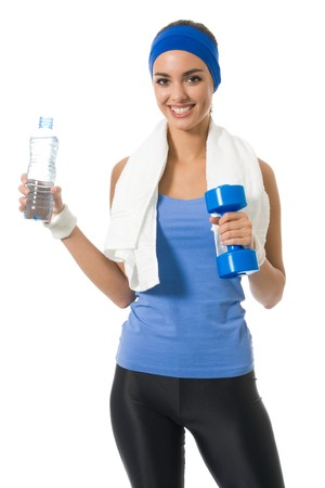Young woman in sportswear with water and dumbbell, isolated  photo