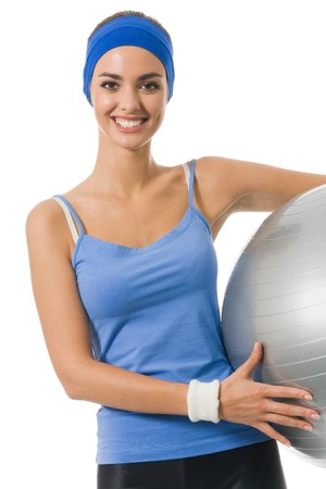 Young happy woman with fitness ball, isolated on white photo