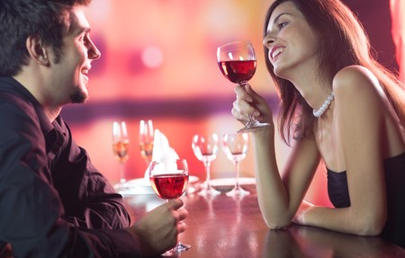 Amorous couple on romantic date or celebrating together at restaurant Stock Photo - 4169079