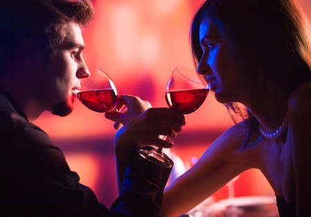 amorous: Amorous couple on romantic date or celebrating together at restaurant