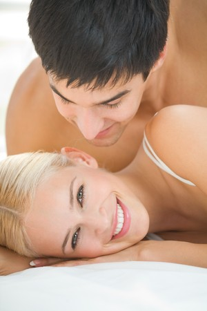 Young attractive happy amorous couple at bedroom Stock Photo - 4169094