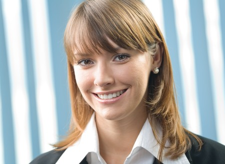 20 25: Portrait of young happy smiling businesswoman at office