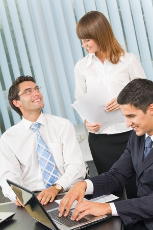 occupied: Successful business team working together at office