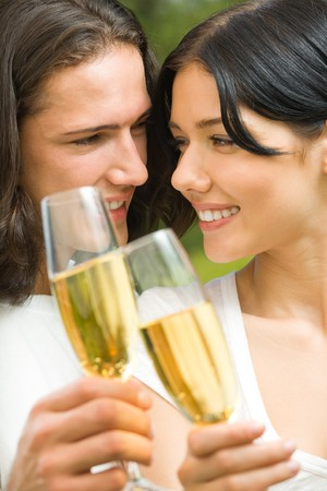 twenty two: Young happy couple celebrating with champagne outdoors Stock Photo