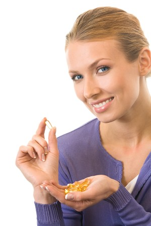 Young happy woman with Omega 3 fish oil capsula, isolated Stock Photo - 4252383