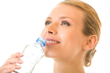 Portrait of young woman drinking water, isolated on white photo