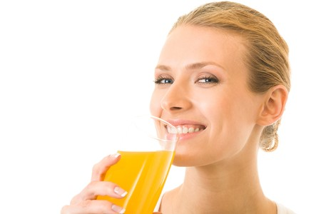 Portrait of young woman drinking juice, isolated on white photo
