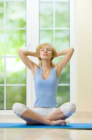 Young woman doing fitness exercises or meditating at home Stock Photo - 4366930