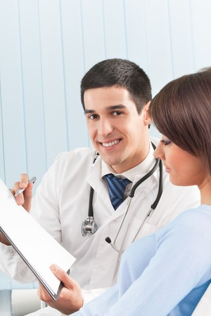 Happy doctor and female patient at office photo