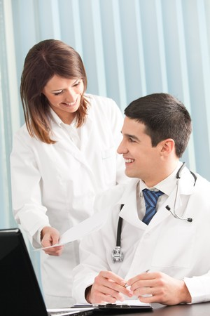 Two happy medical people working together at office Stock Photo - 4408228