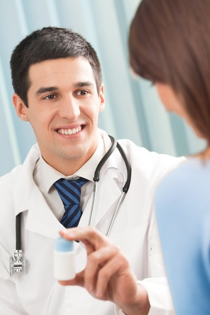 Happy doctor with drug and patient at office Stock Photo - 4408237