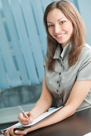 Happy businesswoman signing document at office Stock Photo - 4444224