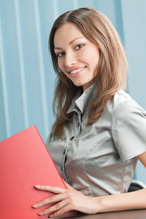 Happy smiling businesswoman with red folder at office Stock Photo - 4444232