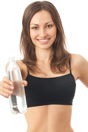 Young happy smiling woman in sportswear with water, isolated Stock Photo - 4444228