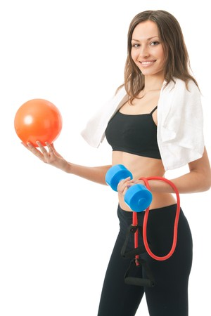 expander: Woman in sportswear with ball, dumbbell, expander, terry towel, isolated