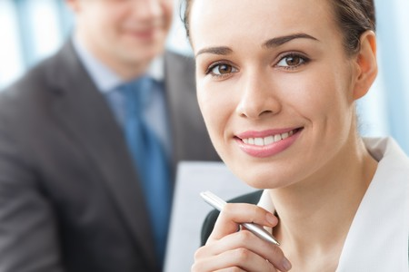 Portrait of successful businesswoman and colleague on background, at office Stock Photo - 4492739