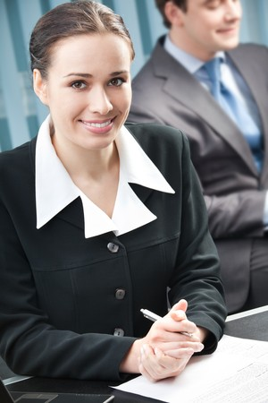 Portrait of successful businesswoman and colleague on background, at office Stock Photo - 4492745