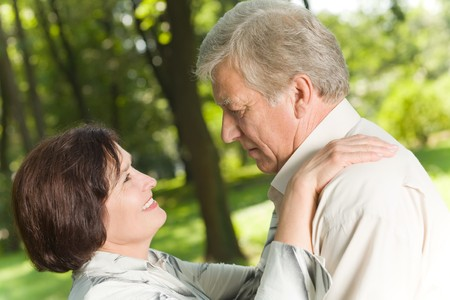 Mature attractive happy couple together in park photo