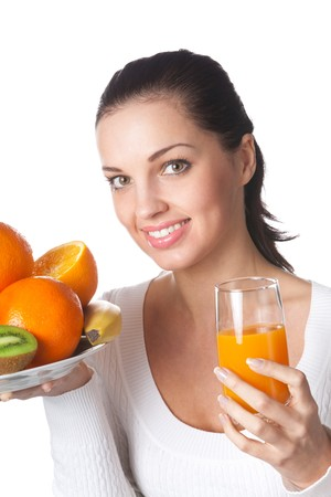 Woman with assorted citrus fruits and orange juice, isolated photo