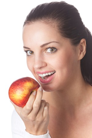 20 25: Portrait of young woman with apple, isolated on white