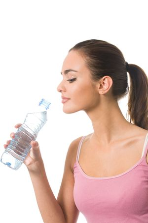Young happy smiling woman in sportswear with water, isolated  photo